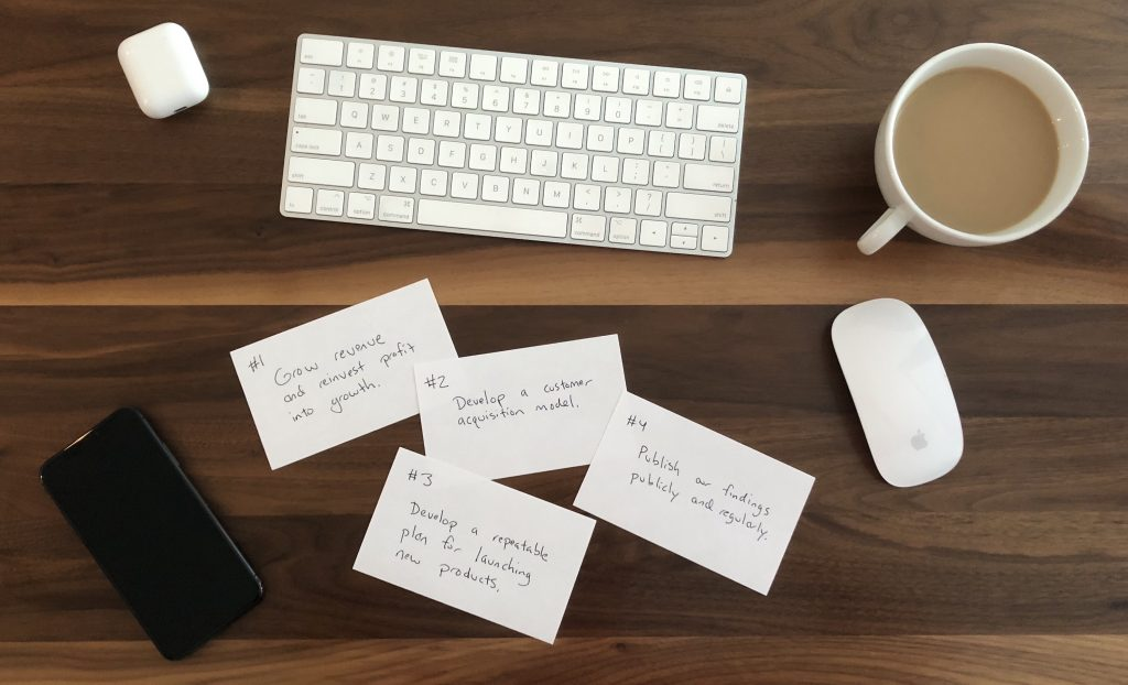 OKRs written on index cards, scattered on a desk.